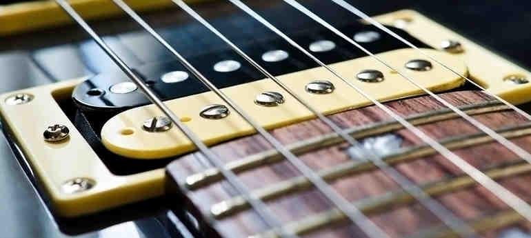 Comment régler la hauteur des cordes de guitare électrique?